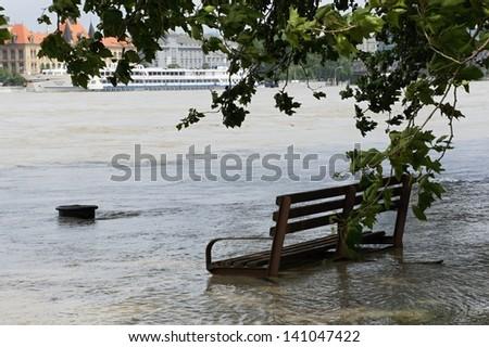 Extraordinary flood, on Danube river in Bratislava, Slovakia, bench in water - stock photo