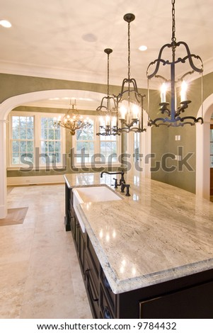 extravagant kitchen looking into diningroom with view - stock photo