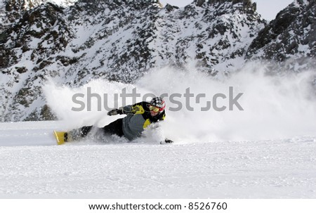 Extreme carving snowboarder - stock photo