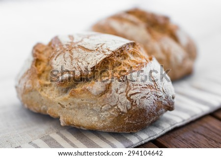 Extreme clos-up of rustic Italian bread, isolated on background out of focus. - stock photo
