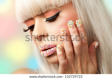 Extreme close up beauty portrait of girl with sugar sprinkle dot make up.