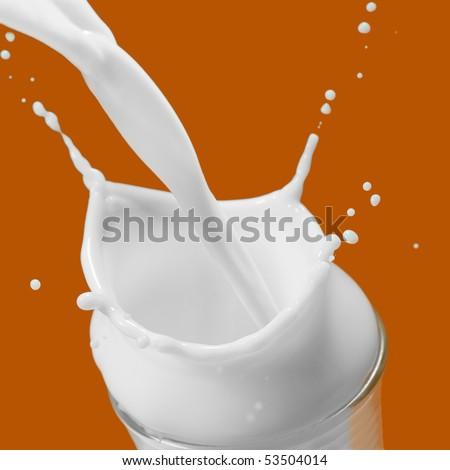 Extreme close-up image of a milk splash - stock photo