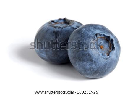 Extreme close-up image of blueberries on white background - stock photo