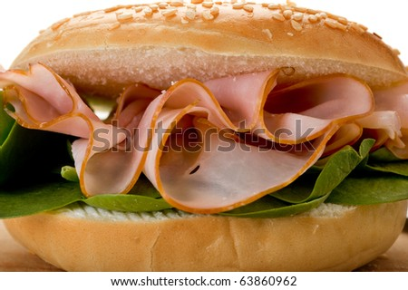 Extreme close-up image of fresh made sandwich with spinach and salami