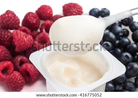 Extreme close-up image of fruit yogurt with fruits around