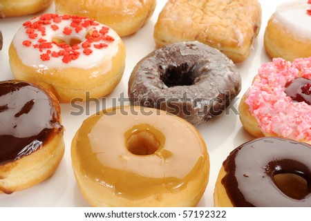 Extreme close-up image of mixed donuts - stock photo