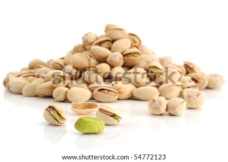 Extreme close-up image of pistachio with more pistachios in background - stock photo