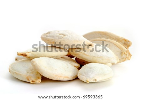 Extreme close-up image of pumpkin seeds studio isolated on white background - stock photo