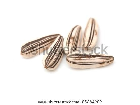 Extreme close-up image of sunflower seeds studio isolated on white background - stock photo