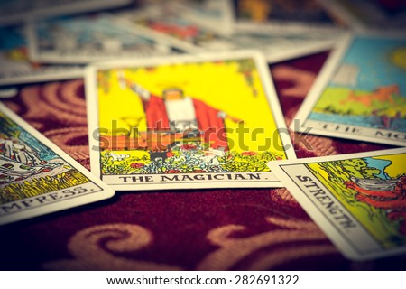Extreme close-up macro shot of The Magician tarot card with shallow depth of field. - stock photo