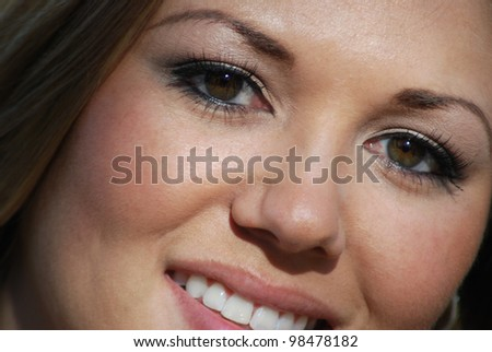 Extreme close up of a beautiful blonde woman. - stock photo