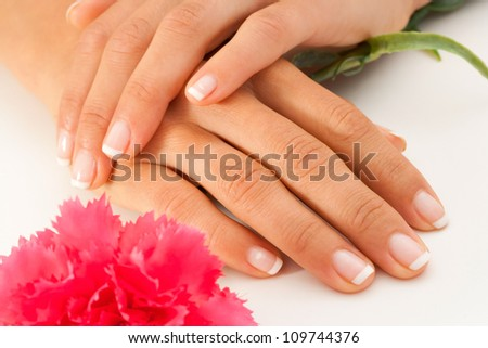 Extreme close up of female hands with french manicure.
