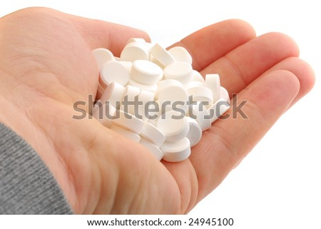 Extreme close-up of hand full of tablets