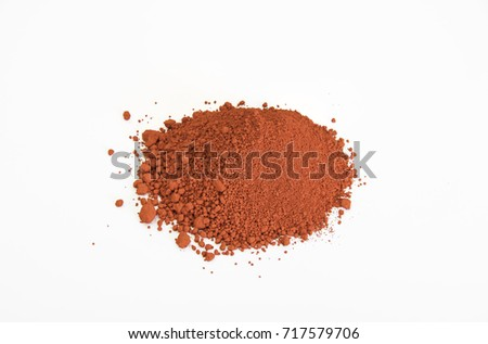 extreme close up of red pigment isolated over white background
