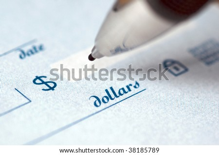 Extreme close up of the dollar amount on a check being written by an ink pen. - stock photo