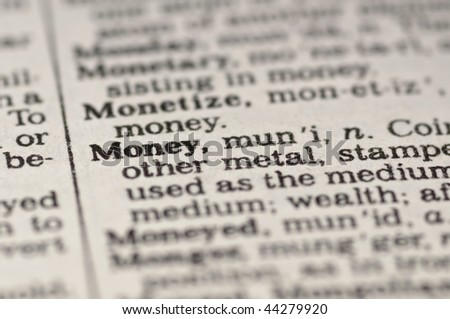 Extreme close up of the word MONEY found inside a dictionary - stock photo