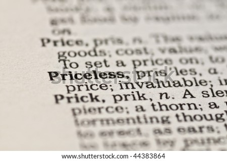 Extreme close up of the word PRICELESS found inside a dictionary - stock photo