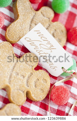 Extreme close-up shot of gingerbread candy with a merry Christmas tag.