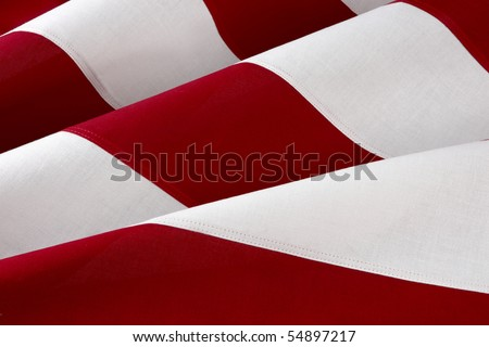 Extreme close up shot of red and white stripes of the American flag