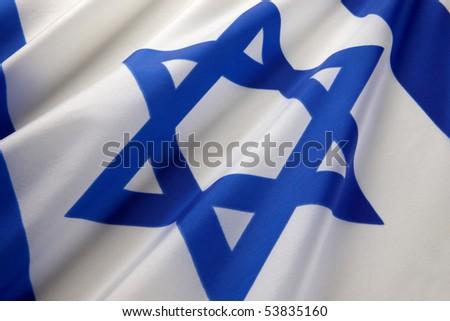 Extreme close up shot of wavy Israeli flag - stock photo