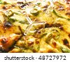 Extreme close-up view of a delicious pizza with olive, mushroom and cheese - stock photo