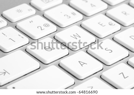 extreme closeup of a modern silver keyboard - stock photo