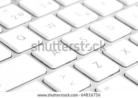 extreme closeup of a modern silver keyboard - stock photo