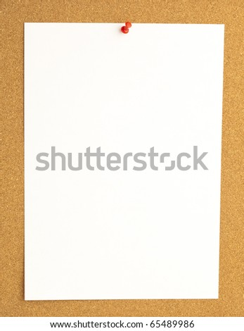 extreme closeup of thumbtack and note on billboard - stock photo