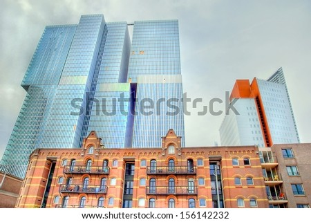 """Extreme HDR of a image from the building """" The Rotterdam""""  at   the south bank of Rotterdam , the Netherlands. Modern architecture combined with old vintage buildings ' past and present architecture  - stock photo"""