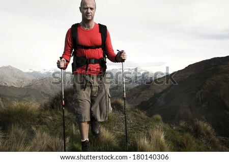 Extreme Hiking Across Rugged Mountains, New Zealand Southern Alps - stock photo