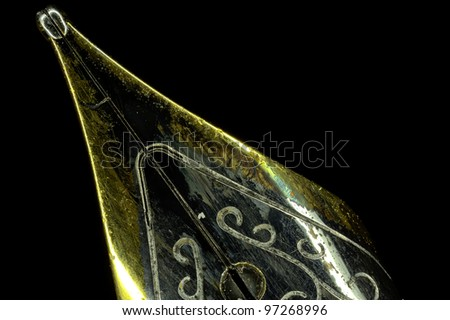Extreme macro of a golden pen with a gold nib. - stock photo