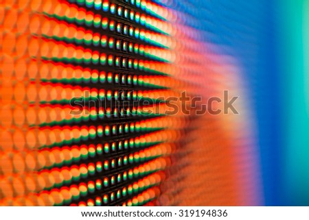 Extreme macro of red and blue colored LED smd screen - background with shallow depth of field - stock photo