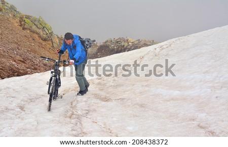 extreme mountain biking in the snow - stock photo