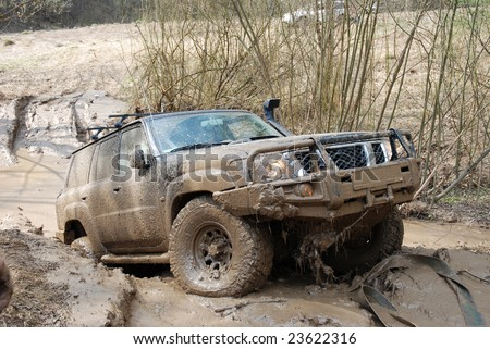 Extreme offroad  car in mud - stock photo