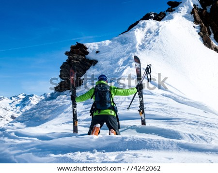 Extreme skier on the summit before going down between the rocks.