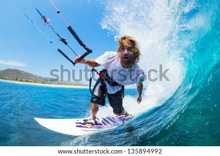 Extreme Sport, Kite Surfer Riding Wave getting Barreled - stock photo