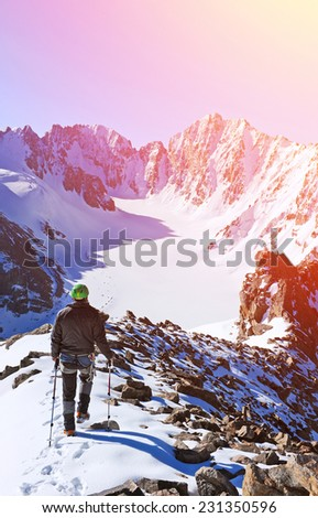 Extreme Sport. Lone hikers in winter mountains - stock photo