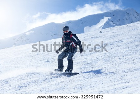 extreme sport,snowboarder in action at the mountains