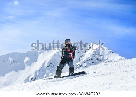 extreme sport,snowboarder in action at the mountains Young man snowboarding