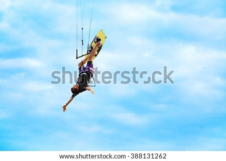 Extreme Sport. Water Sports. Kiteboarding, Kitesurfing Action. Professional Kiter Makes Difficult Trick In Air. Active Lifestyle. Hobby. Recreational Sporting Activity. Summer Fun, Adventure.