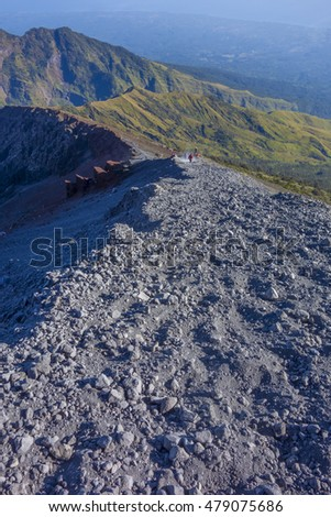 Extreme view of Rinjani mountain route. The route is mostly made of small pebbles and volcanic sand ashes.