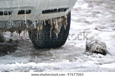 Extreme winter series. Car in ice. Icicles on a wheel arch close - stock photo