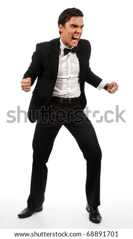 Extremely angry businessman part his hands with fists and roaring wearing a suit