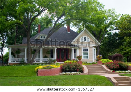 Extremely colorful classic restored house in rural city - stock photo