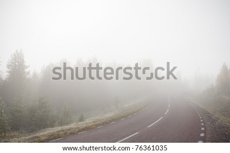 Extremely foggy road - stock photo