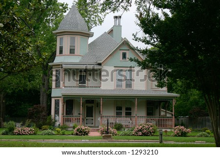 Extremely ornate and colorful restored Victorian era house in rural city - stock photo