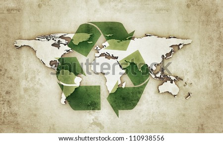 extruded continents with recycle symbol in old grunge photo