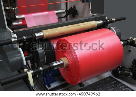 Extruder of polyethylene for process production of plastic bags - stock photo