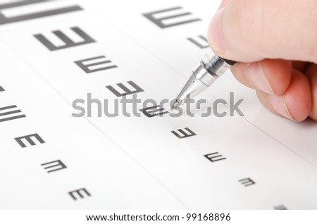 Eye chart and pen - stock photo