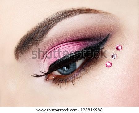 Eye close up with beautiful make-up, macro photography - stock photo